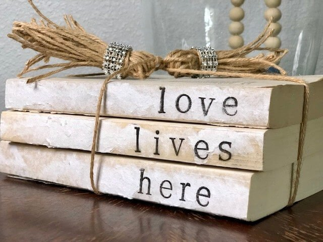 love lives here vintage handstamped book decor with bling tassels final