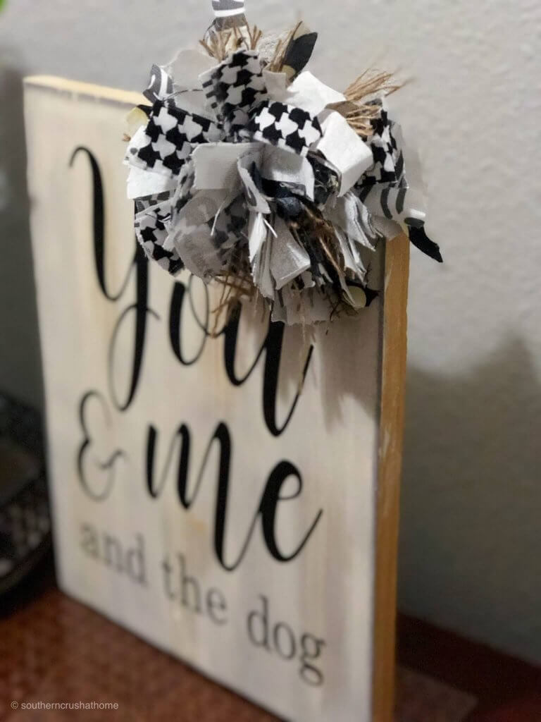 Scrap material turned into a messy bow, then attached to a sign.