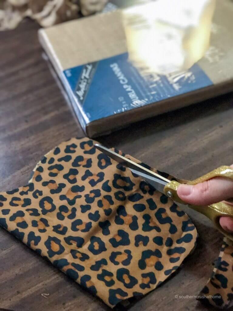 Cutting leopard print fabric for a DIY pumpkin wall art
