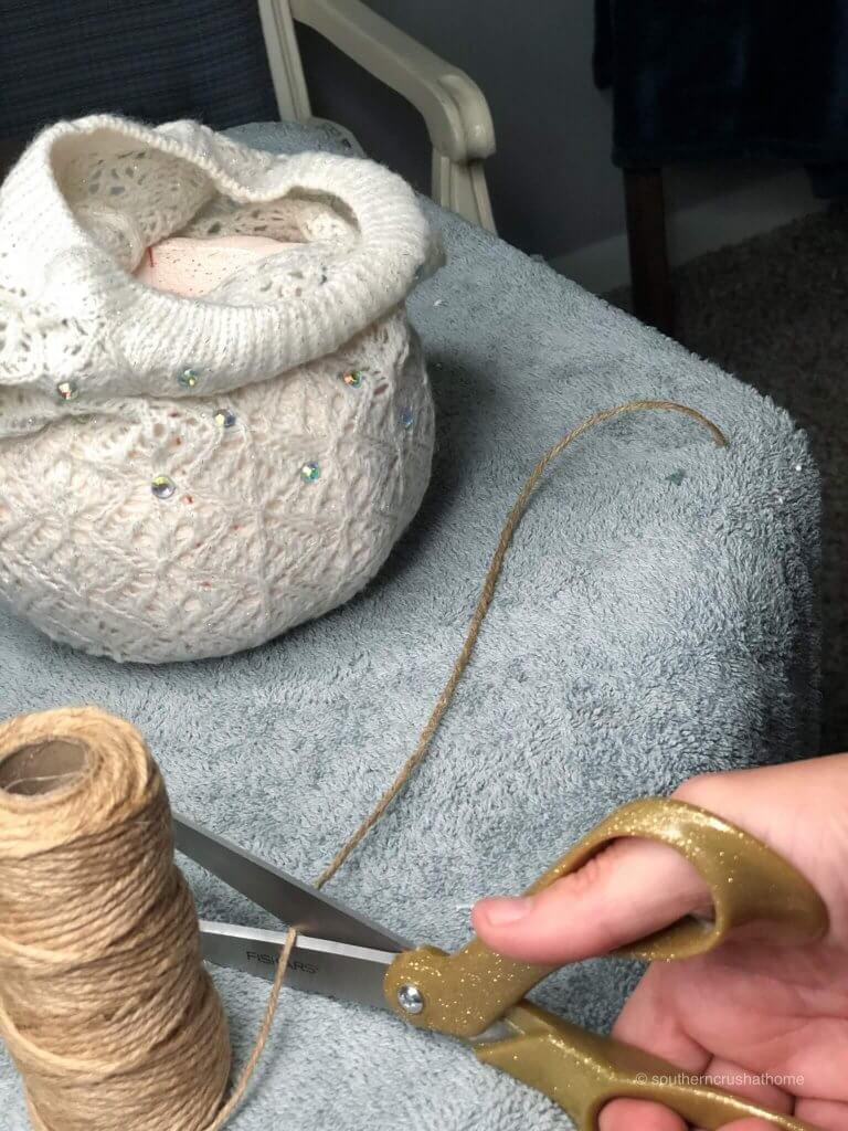 Adding twine to the DIY Pumpkin Decor