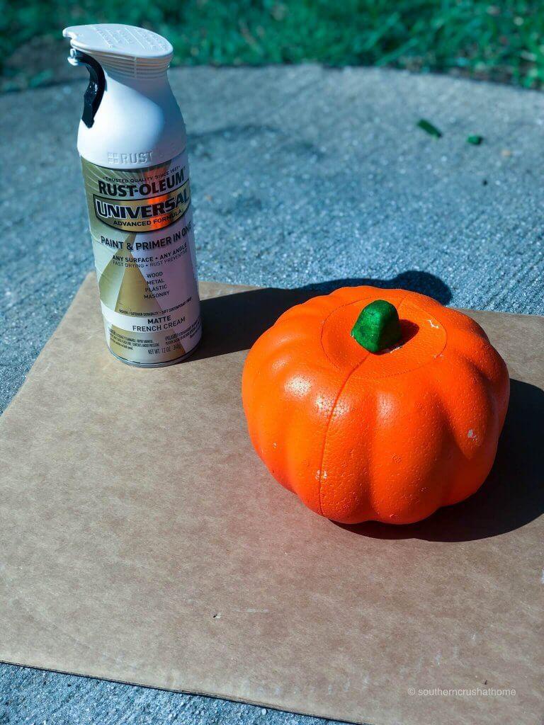 Spray paint and an orange Styrofoam pumpkin