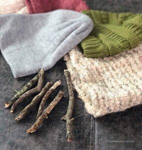 Supplies to make DIY pumpkin decor - beanie hats and sticks