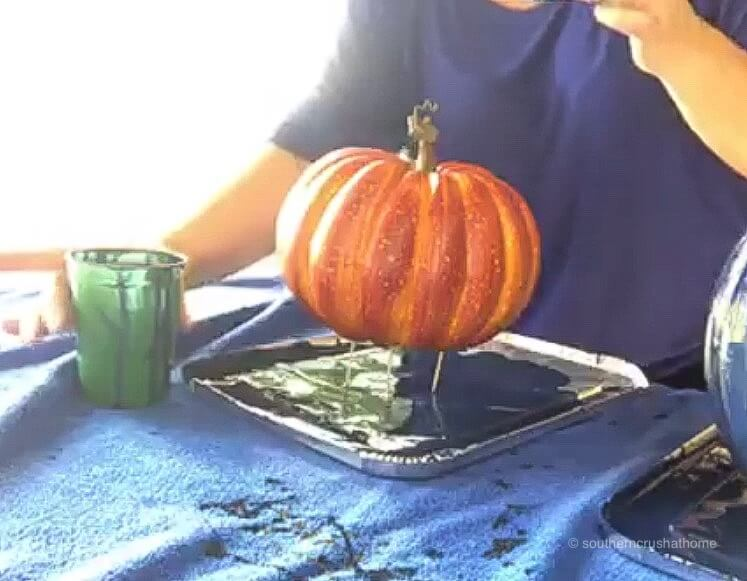 toothpicks in the bottom of a Styrofoam pumpkin