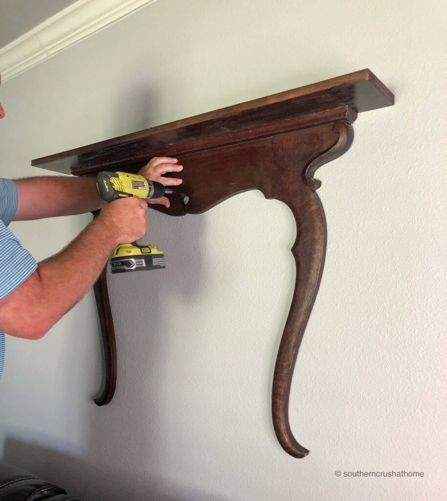 Attaching the shelf to the wall