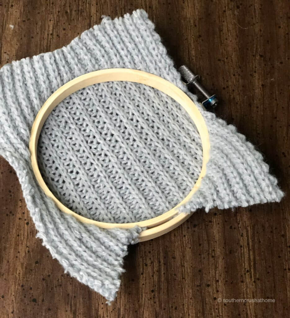 The backside of the sweater piece and the embroidery hoop