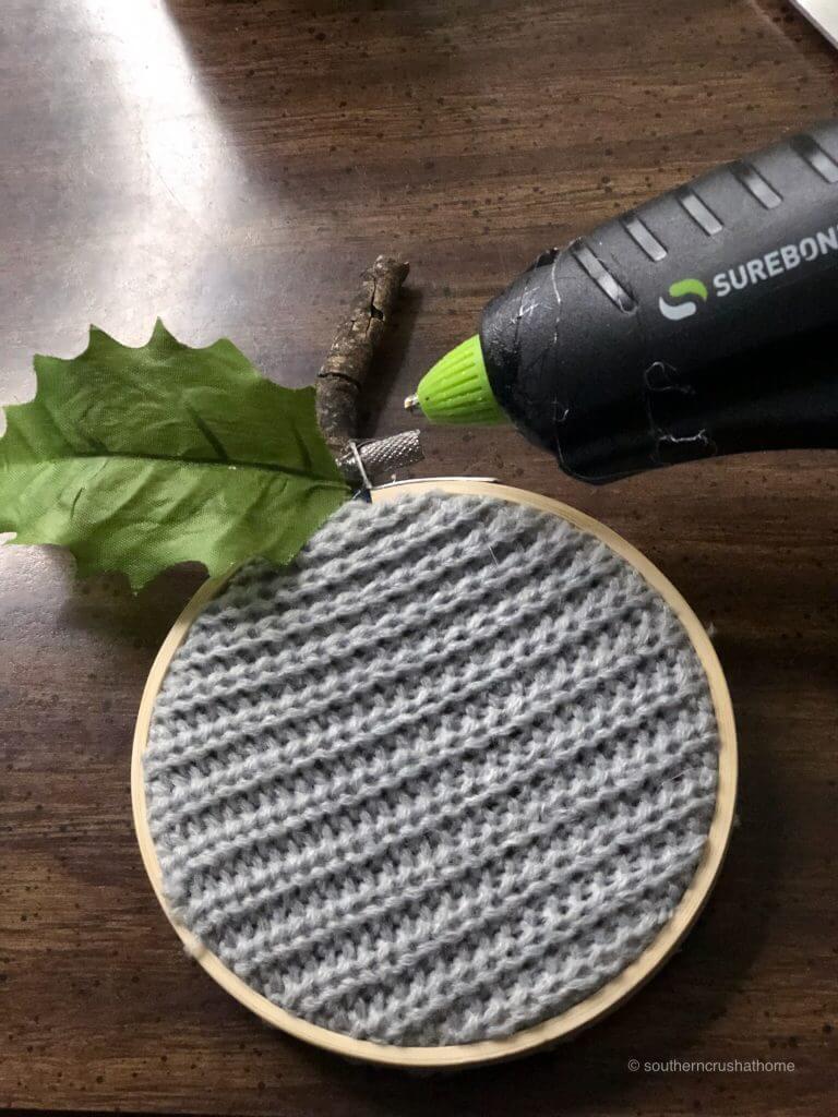 Gluing a fake stem on fabric pumpkins