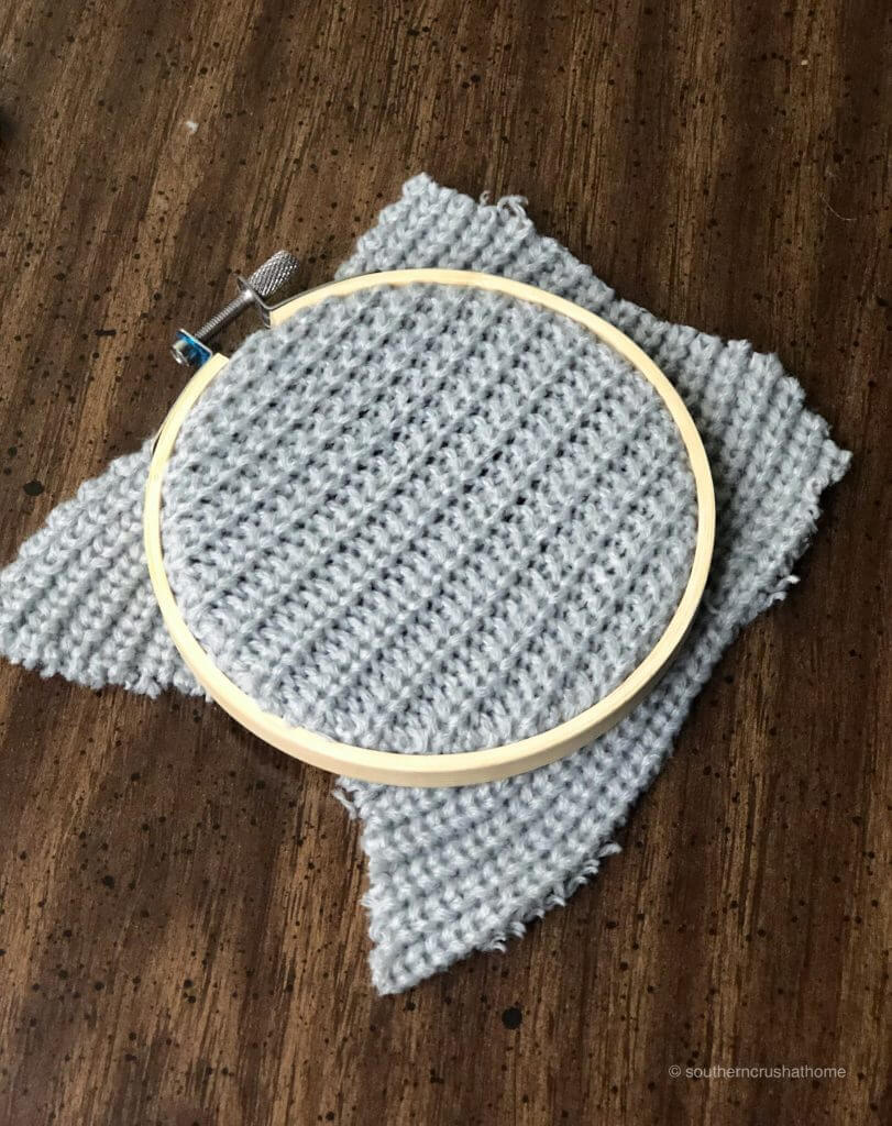 Placing the sweater inside the embroidery hoop