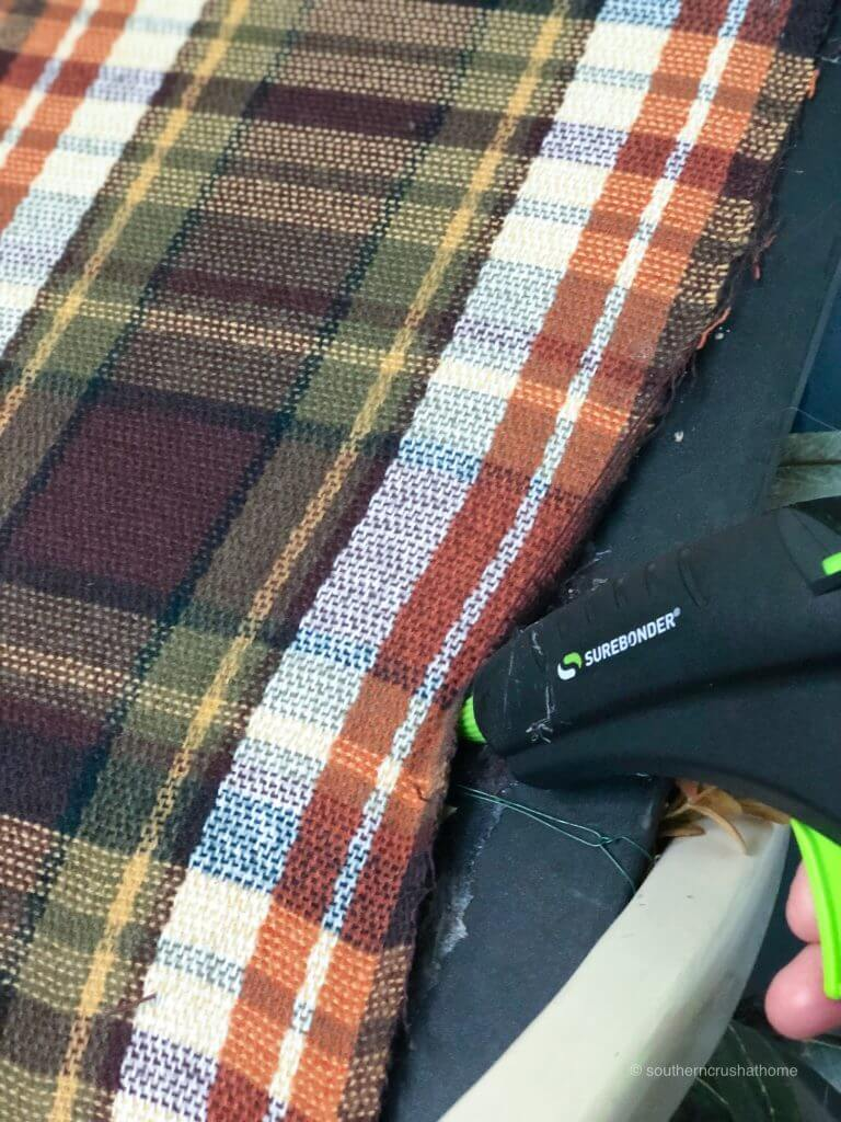 Gluing plaid fabric to the frame