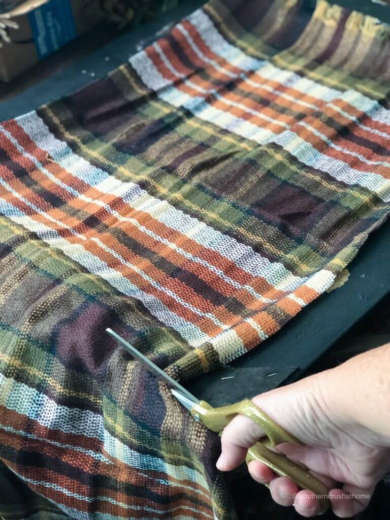 Trimming plaid material to fit the frame
