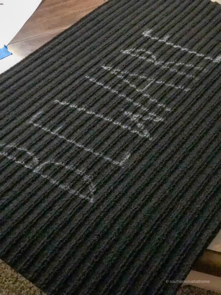 The word beware on a black doormat