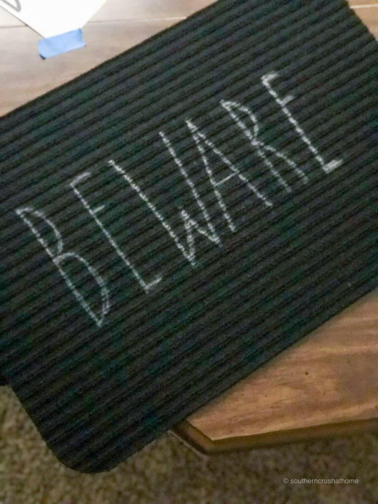 Beware in Rae Dunn Font on a black doormat