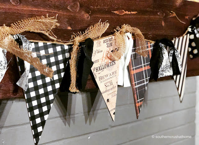 DIY Halloween banner hanging on the mantel