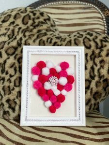 reverse canvas pom pom heart diy