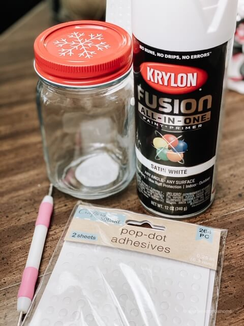 Supplies for a DIY hobnail milk glass - a jar, pop-dot adhesives, and Krylon primer