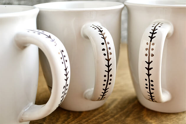 Ceramic mug with Sharpie on the handle