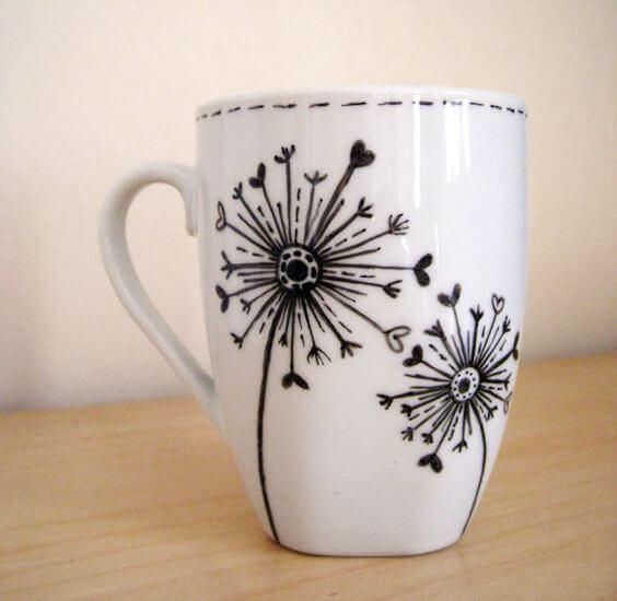 Dandelion design with Sharpie on a mug