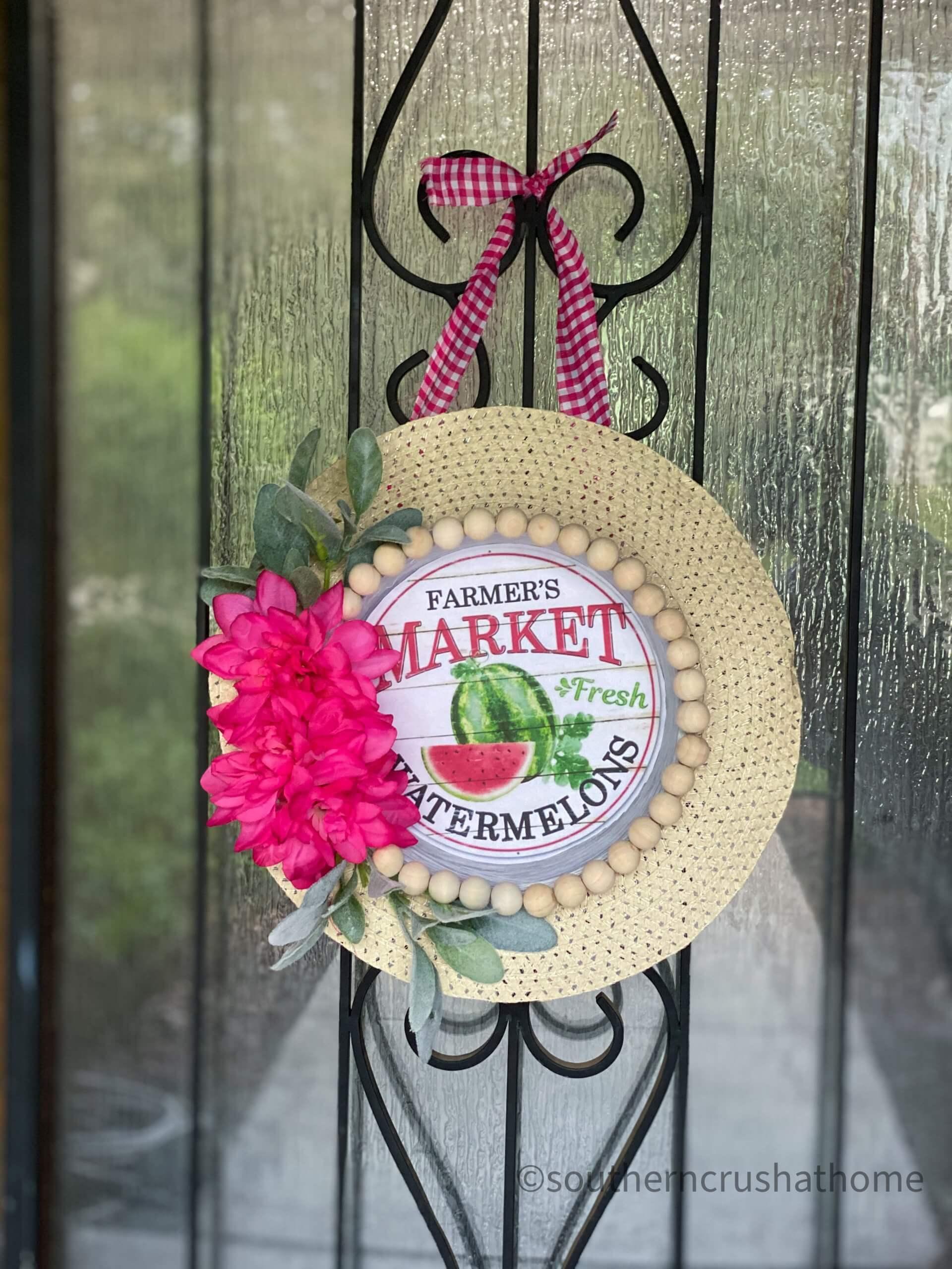 Dollar Tree summer sun hat wreath hanging on the front door