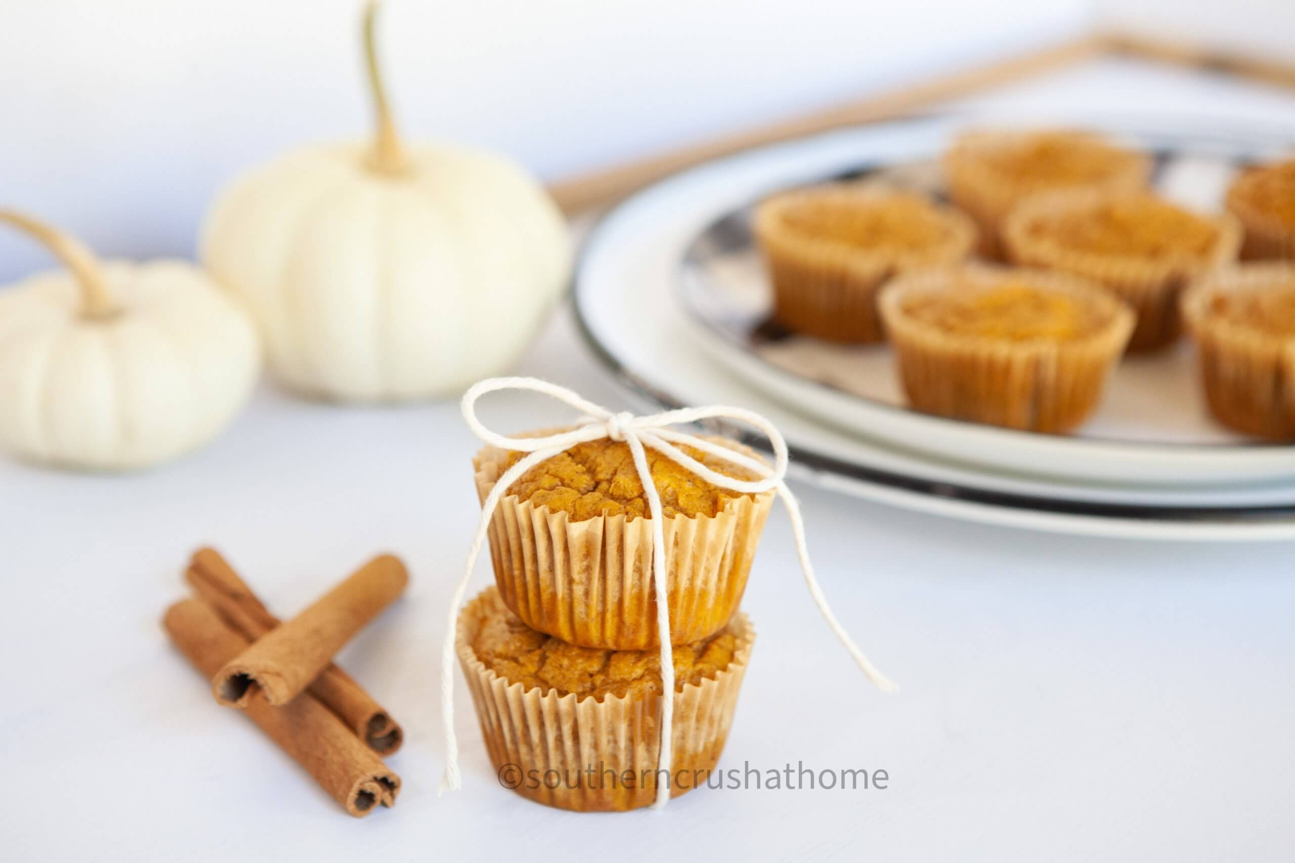 3 ingredient pumpkin muffins stacked with twine