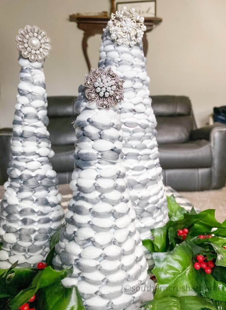 Christmas Cone Trees with holly close up