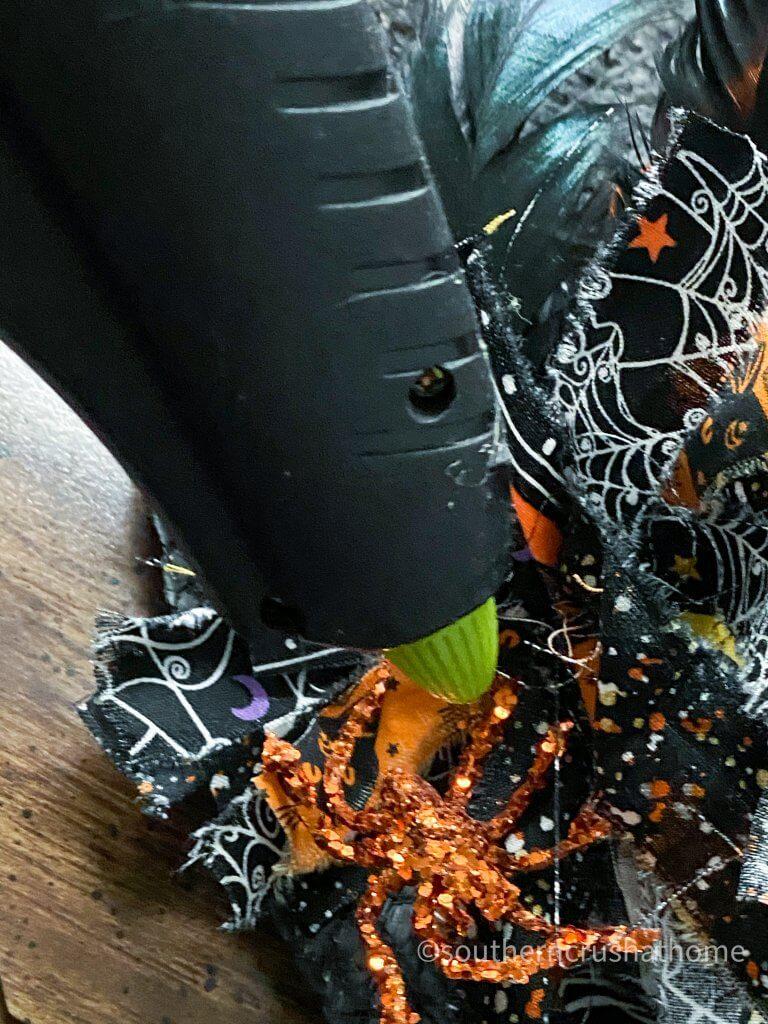 Halloween Witch Hat DIY gluing glitter spider