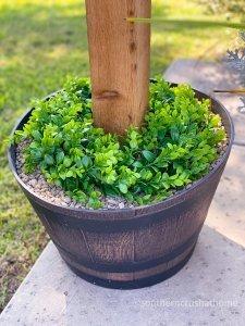 outdoor patio lighting & privacy diy wreath in barrel