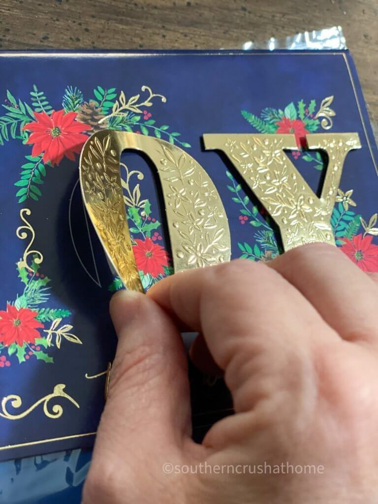 peeling off lettering from Christmas card
