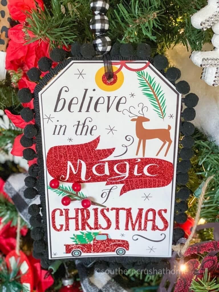 dollar tree christmas gift bag decor on christmas tree