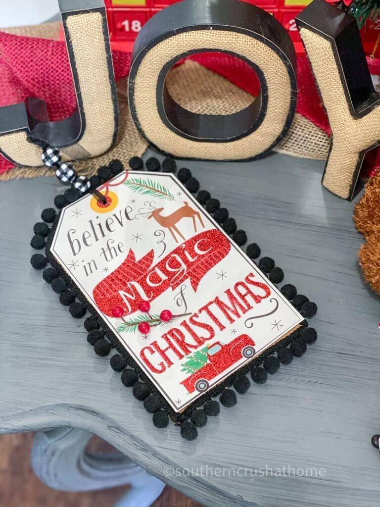 dollar tree christmas gift bag decor on entry table