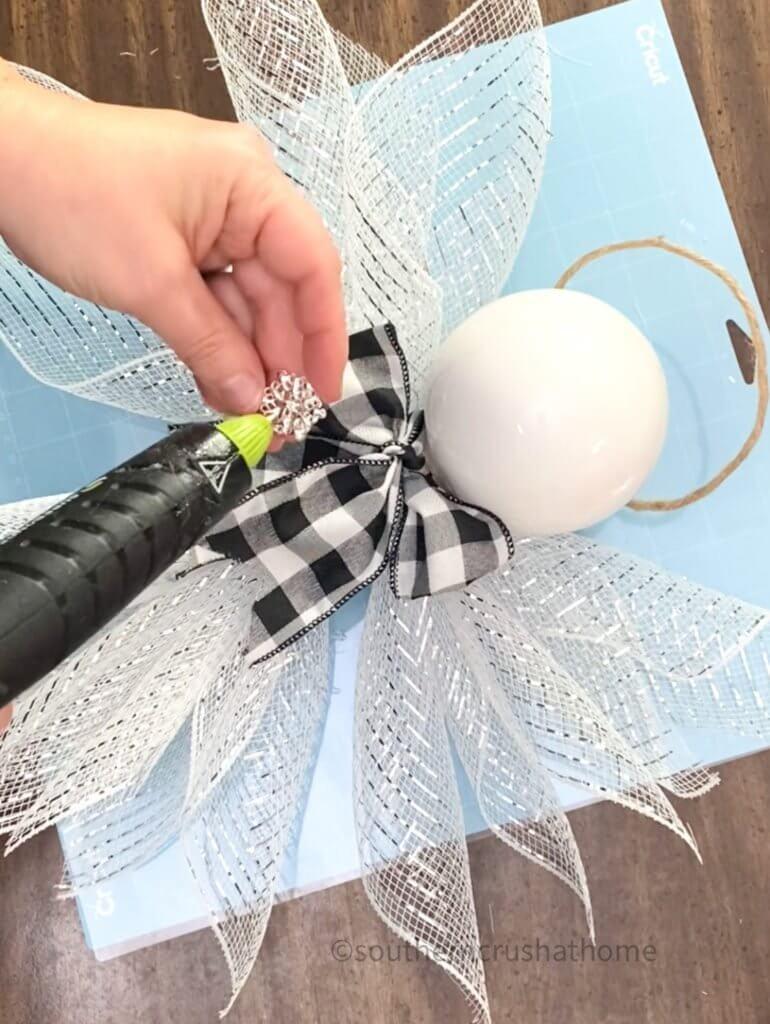 gluing embellishment onto bow