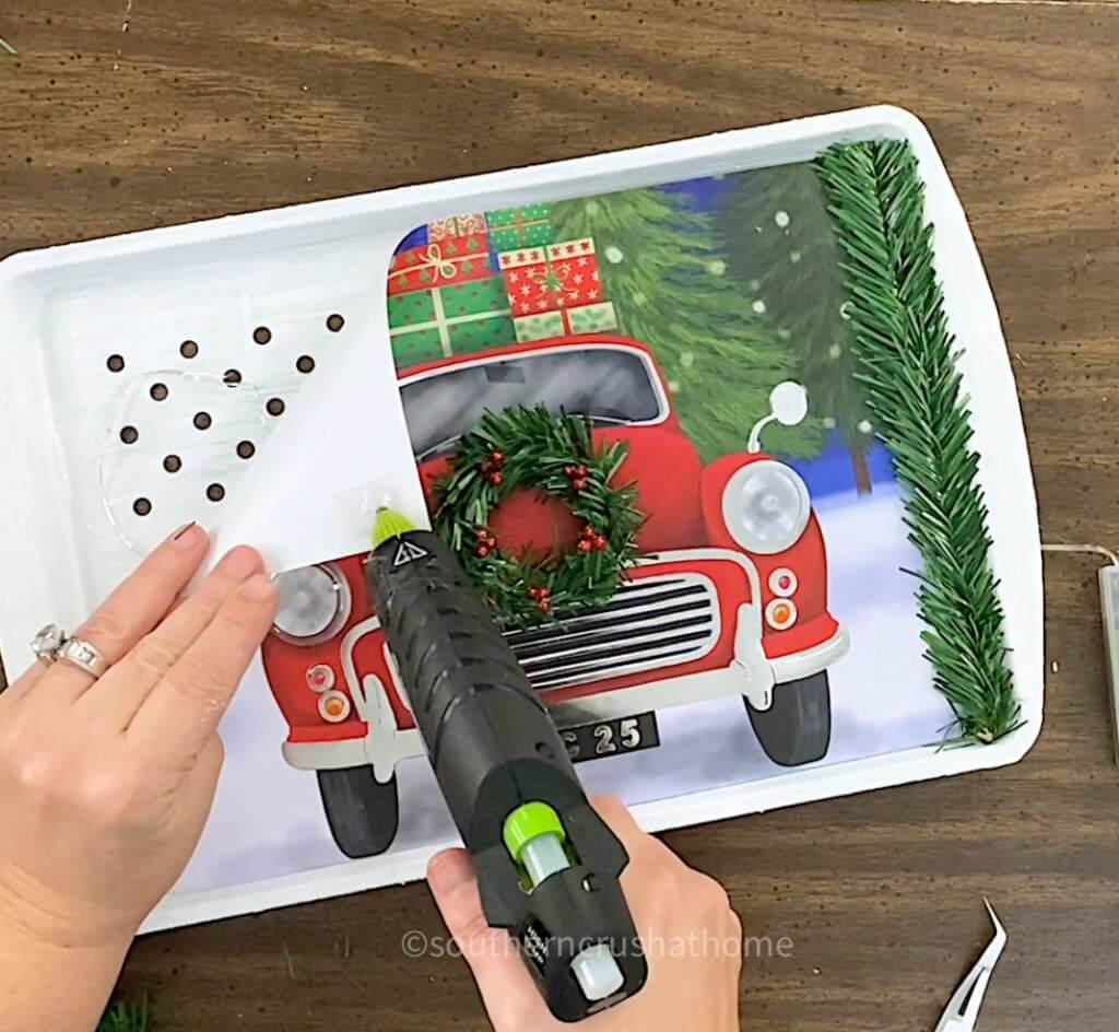 gluing gift back to grill pan