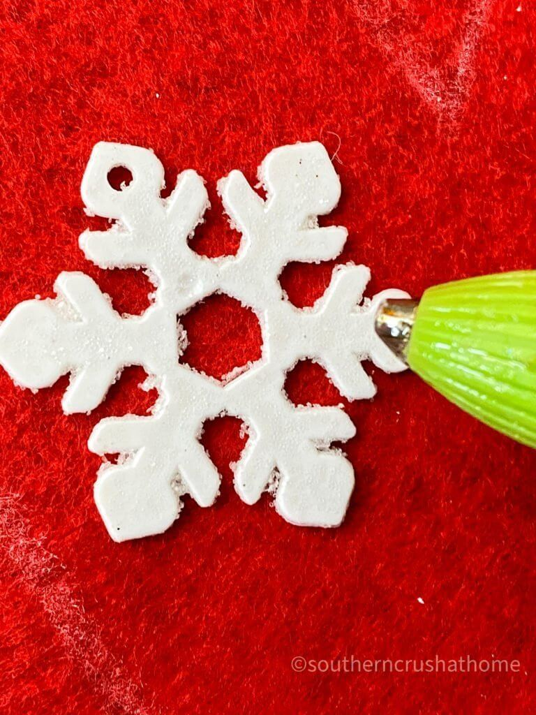 gluing snowflake ornament with hot glue