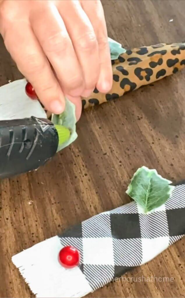 gluing leaves to gnome hat