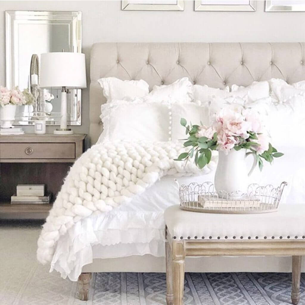 chunky knit throw white bedroom with pink flowers and bench