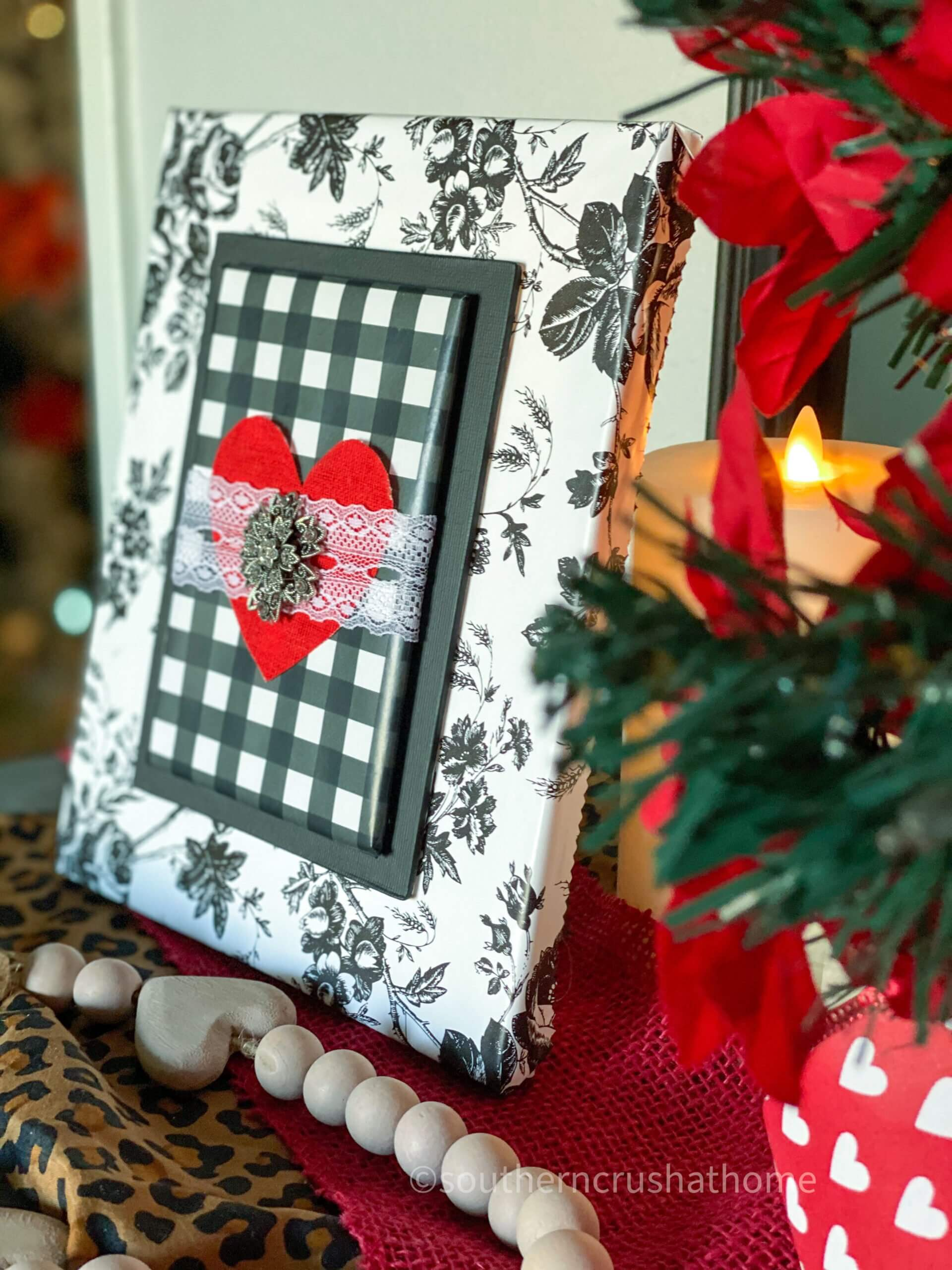 angle view of black and white dollar tree canvas valentines diy