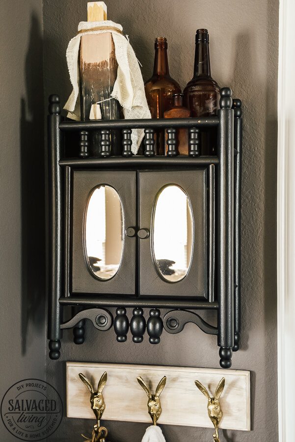 black painted medicine cabinet on wall