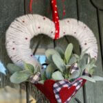 heart wreath diy hanging on front door styled