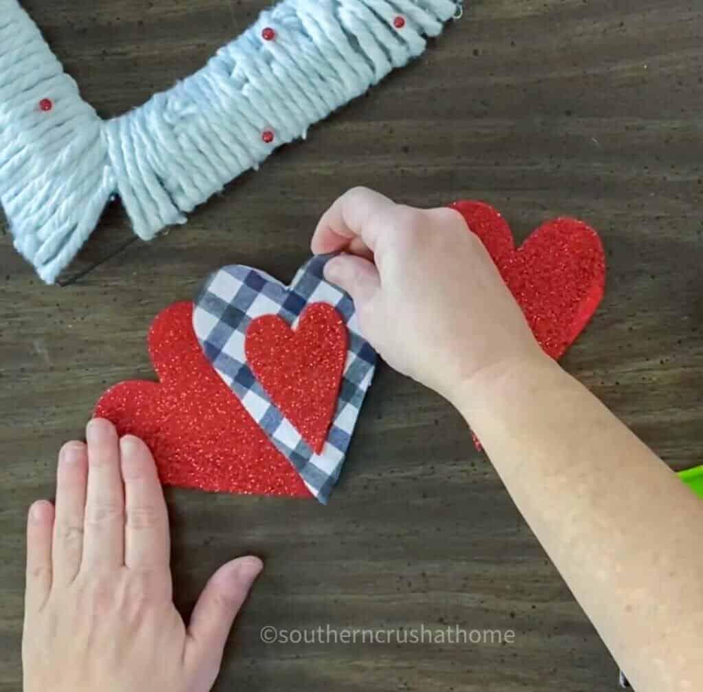 gluing felt hearts together