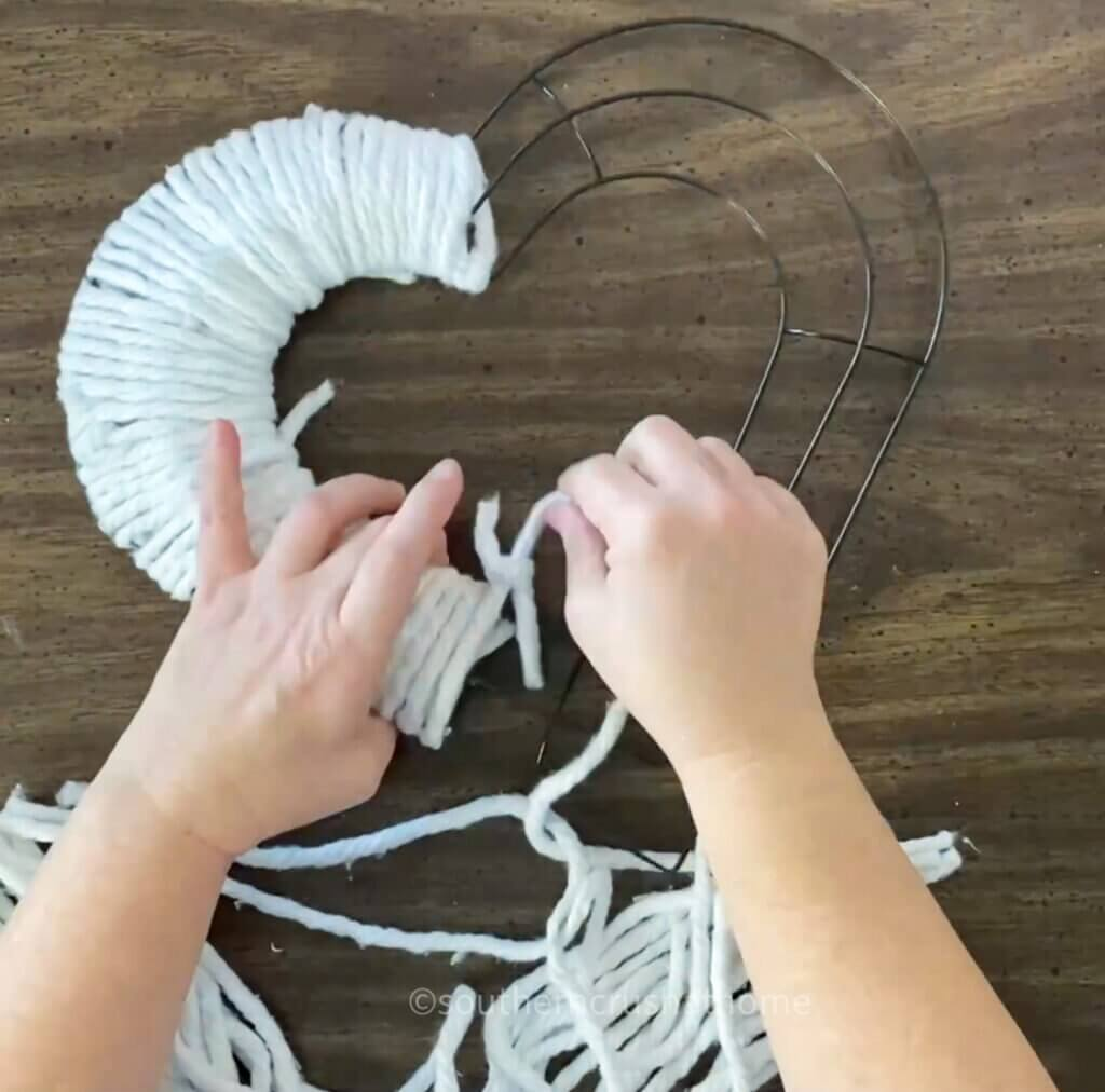 wrapping mop head strands around wire wreath frame