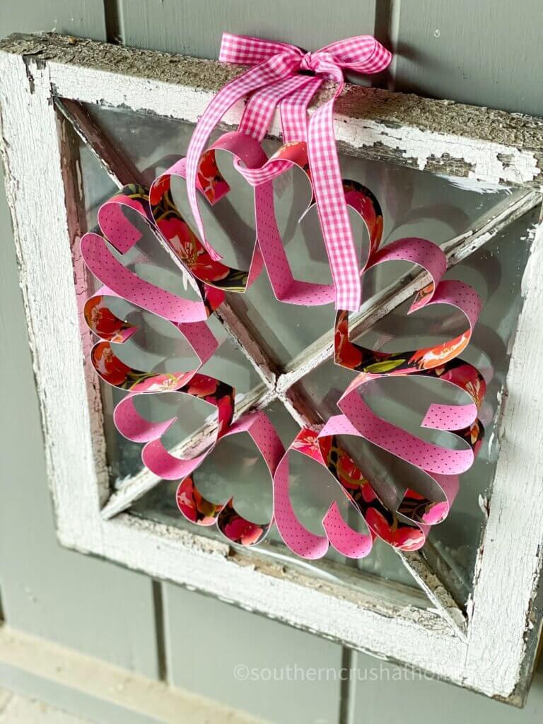 paper heart wreath on vintage window