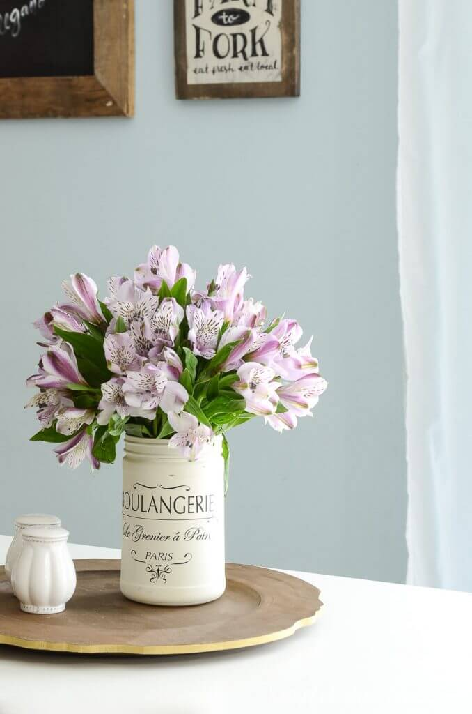 diy wood sign with vase of flowers
