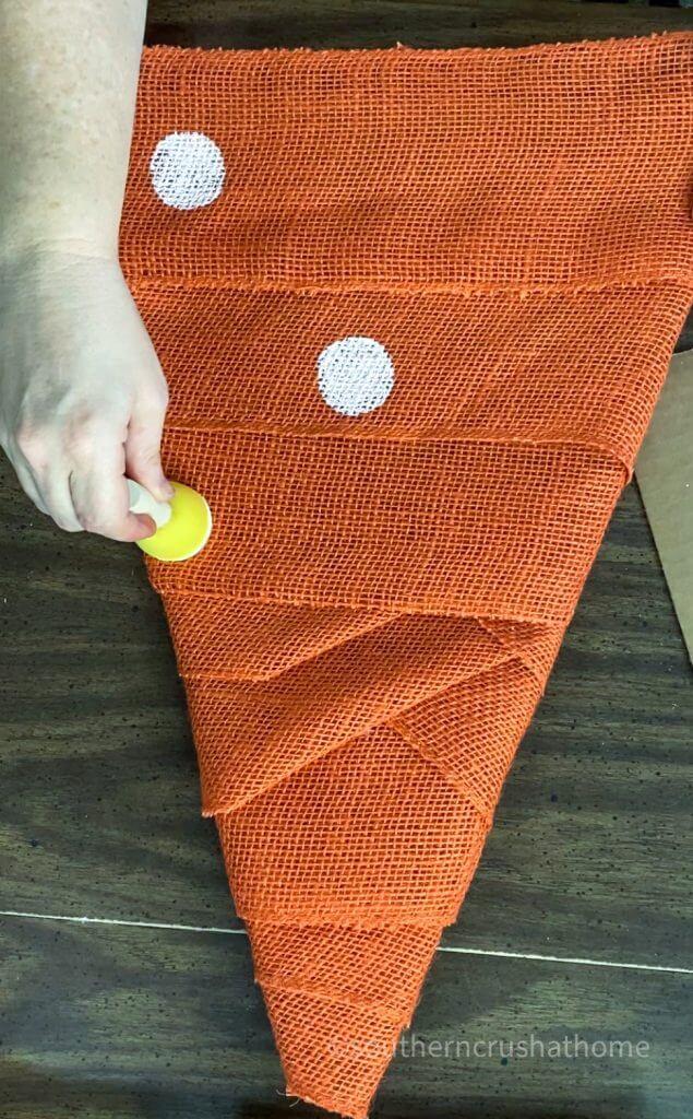 orange burlap wrapped on cardboard