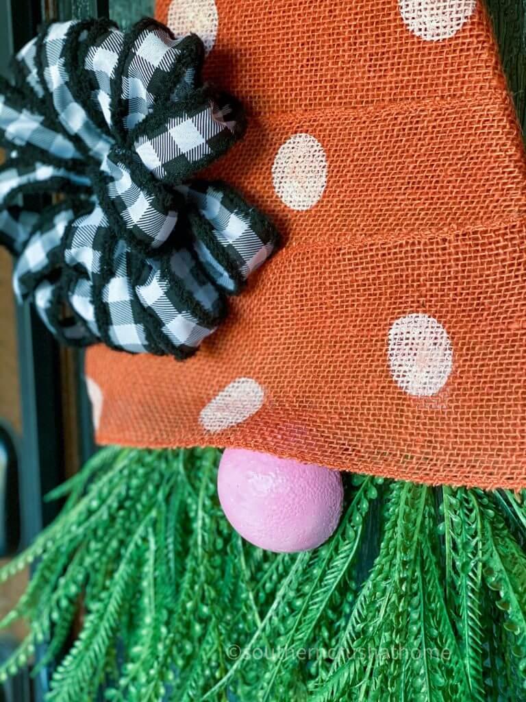 close up of burlap carrot gnome