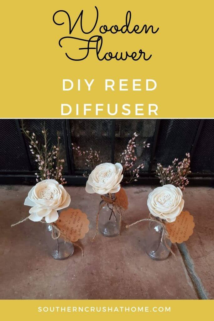 3 glass vases with wooden flowers
