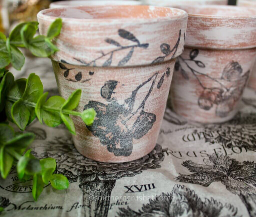 close up of stamped flower on dollar tree terra cotta pots