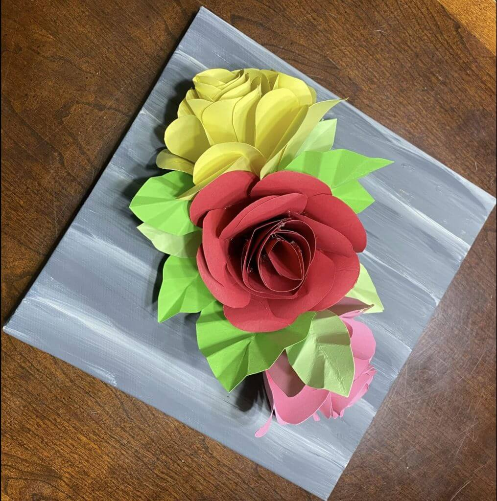 paper rose bouquet on table