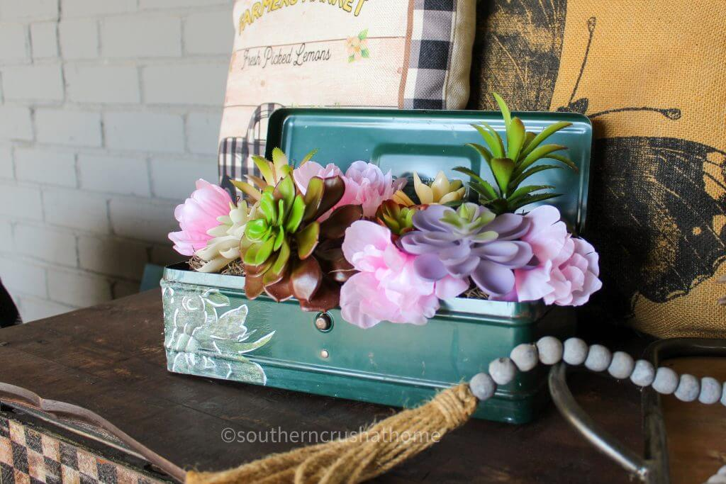 vintage tool box with silk flowers