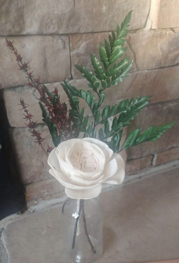 single wooden flower in vase