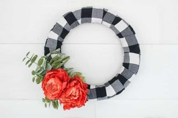 diy farmhouse spring wreath on white shiplap