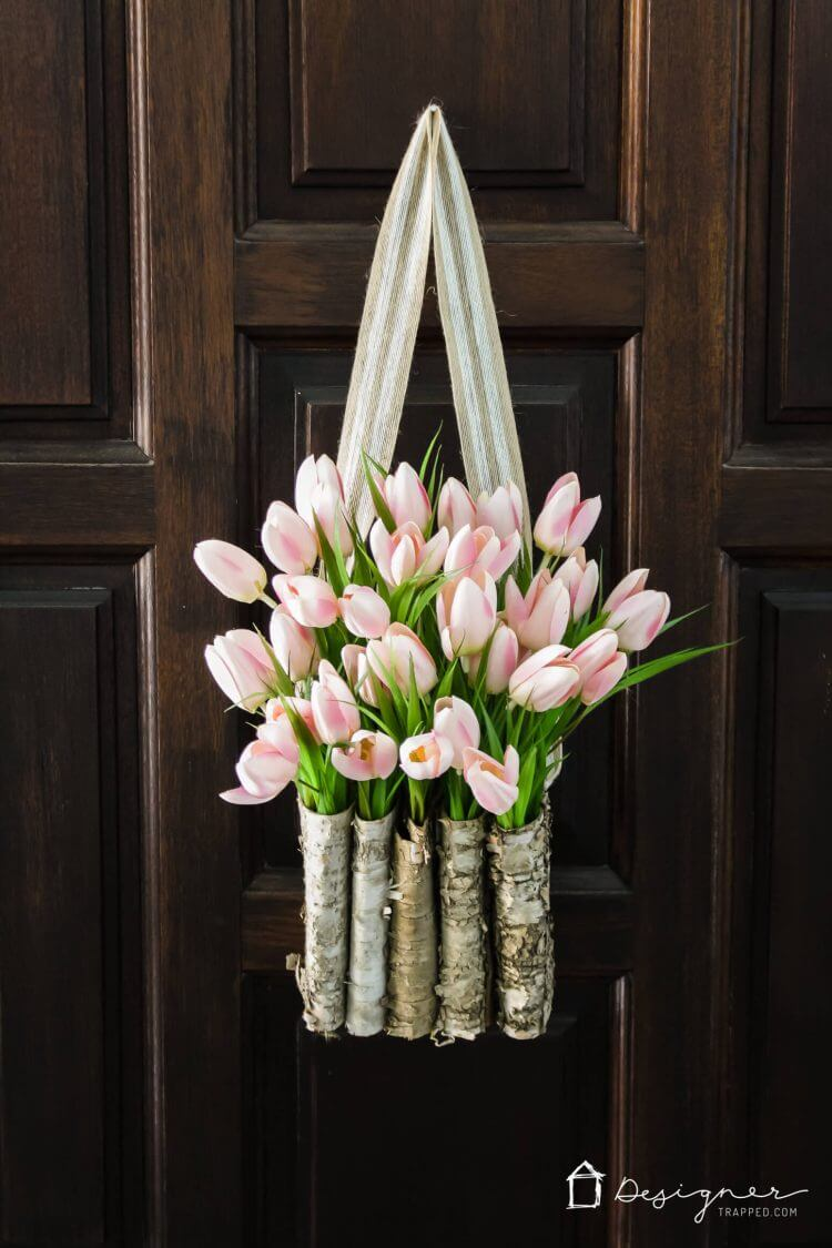 tulip in wood basket on door