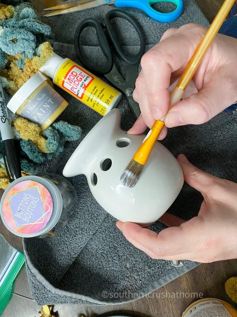 applying modpodge to dollar tree wax warmer